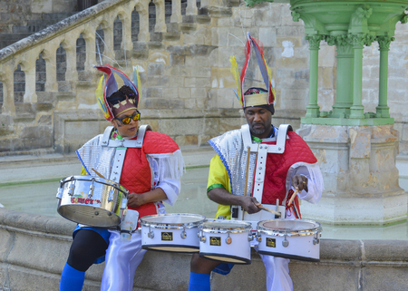 LE MANS, FRANCE - APRIL 22, 2017: Festival Europe jazz Actors in caribbean costume play the drums in downtown of Le mans France