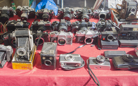 Lisbon, Portugal - August 05, 2017: Collection of old vintage cameras at the flea market