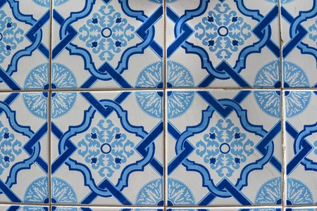 Old tiles of Portugal, detail of a classic ceramic tiles azulejo, art of Portugal Фото со стока