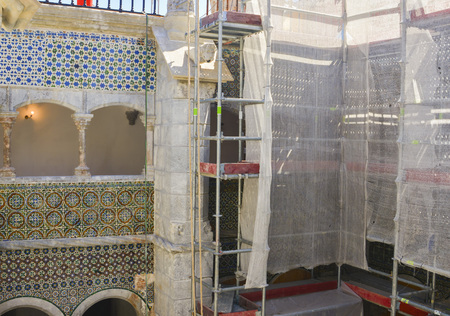 Scaffolding near a building with a historical tile azulejos Renovation Banco de Imagens