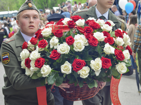 PYATIGORSK, RUSSIA - MAY 09, 2017: Military solders lay flowers to the monument to the fallen soldier