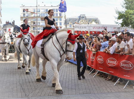 LE MANS, FRANCE - JUNE 13, 2014:White horse with rider.Parade of pilots racing Editorial