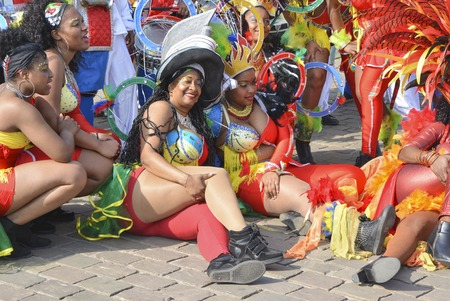LE MANS, FRANCE - APRIL 22, 2017: Festival Europe jazz Dance women sit on the ground to be photographed in Caribbean costumes Editorial