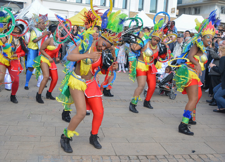 LE MANS, FRANCE - APRIL 22, 2017: Festival Europe jazz The caribbean women dancing in costumes in downtown