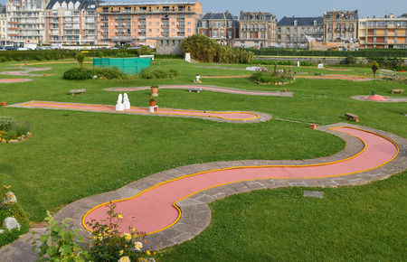 Mini golf club in a small park Imagens