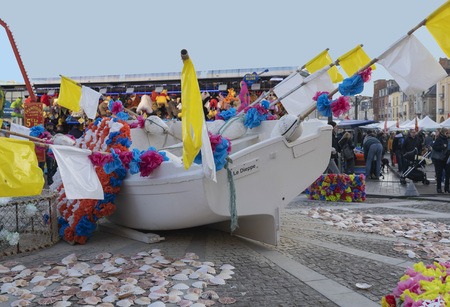 DIEPPE, FRANCE - NOVEMBER 17, 2018: Flowers decorated boat at a Fair of Herring and scallop shell.