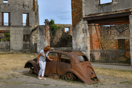 Destroyed cars and buildings during World War 2 in the city Oradour sur Glane France