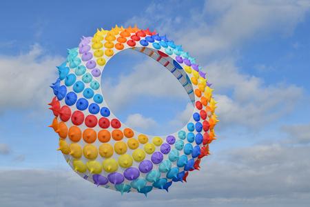 Multicolored air kite in the sky in Atlantic ocean