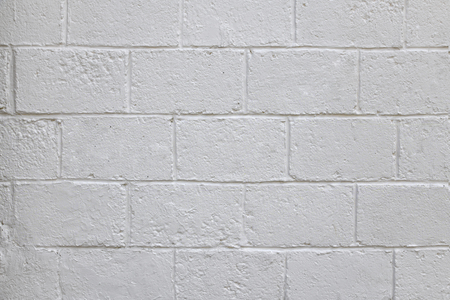The old white concrete tile wall background and texture