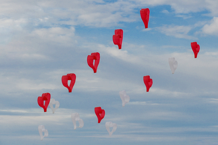 Red and white kites hearts are flying in the wind 版權商用圖片