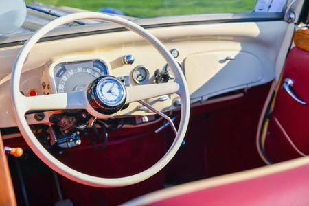 Vintage retro car interior with wheel and dashboard 版權商用圖片