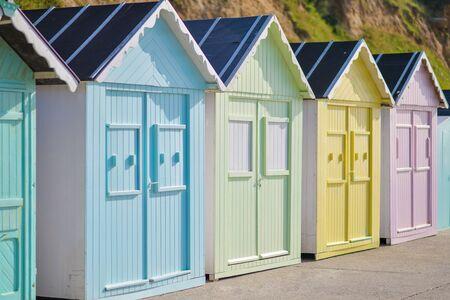 Colored wooden houses on the ocean Saint aubin sur mer