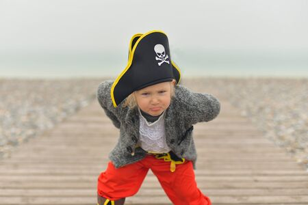 The little girl is wearing a pirate costume