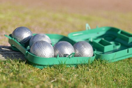 Petanque balls in a box on the grass Stock Photo