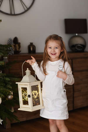 Girl holding a lantern with lights Foto de archivo