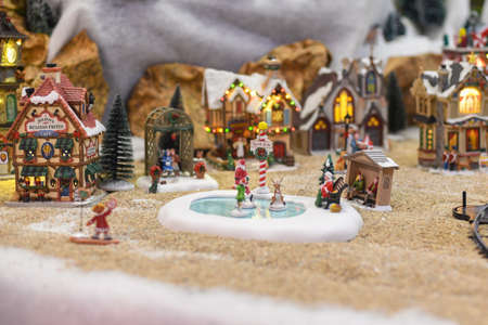 PARIS, FRANCE - NOVEMBER 29, 2019: Winter scene from ceramic figures for Christmas in a shop