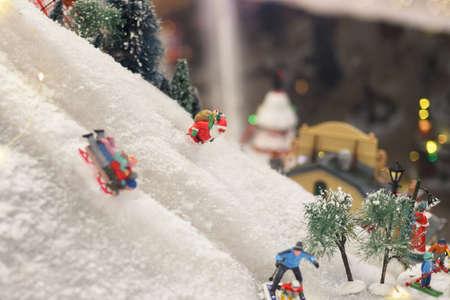Santa Claus is skiing in the snow Winter scene from ceramic figures Foto de archivo