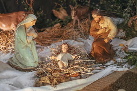 Christmas creche with Joseph Mary and small Jesus in a crib