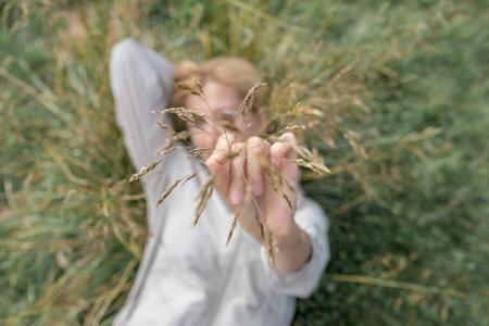 Girl showing dry golden grass