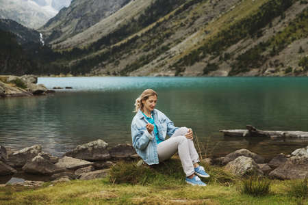 Girl near a french lake Gaube at the high pyrenees