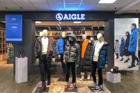 INGRANDES, FRANCE - AUGUST 24, 2020: Well-known French brand AIGLE mannequins in down jackets Factory Store.