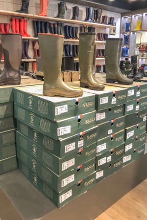 INGRANDES, FRANCE - AUGUST 26, 2020: Well-known French brand AIGLE rubber boots in the store. Factory Store.