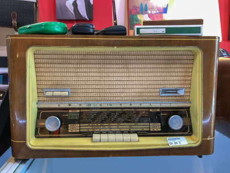 VERONA, ITALY - AUGUST 16, 2019: Vintage old radio Marelli in a second hand shop Editorial