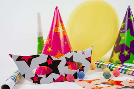 Colorful party items for birthday on a white background