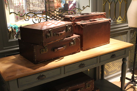 old fashioned: Old fashioned suitcases on table Stock Photo