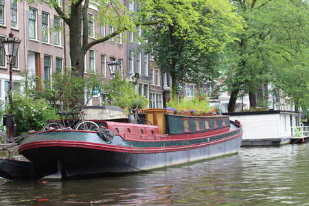 amsterdam canal: Boat on Amsterdam Canal Stock Photo