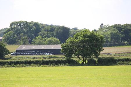 farm building: Farm Building in Countryside Setting Stock Photo