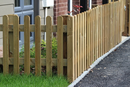 picket: Wooden picket fence on. Stock Photo