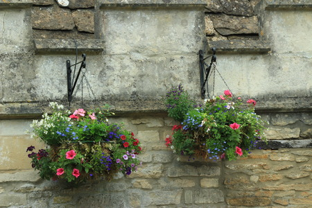 cotswold: Hanging Baskets on Old Building