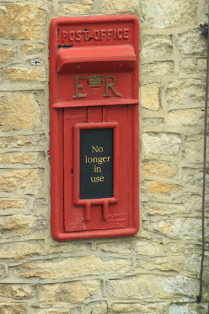 red post box: Red Post Box in Village Stock Photo