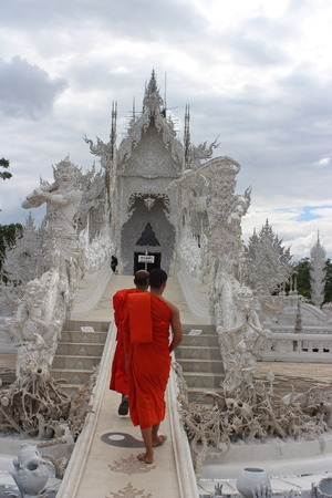 Monks walk up to Wat Rong Khun, The White temple, Chiang Rai