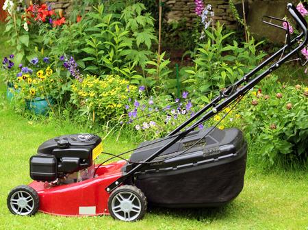 Lawn Mower in English Garden Stock Photo - 58995131