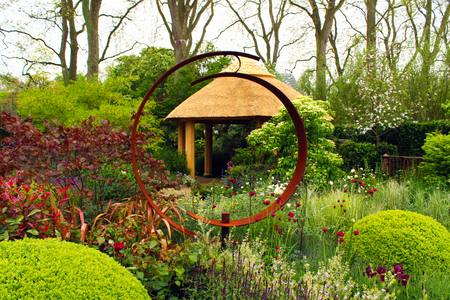 garden features: Landscape Design Garden Design - Shed surrounded by planting. Red sculpture