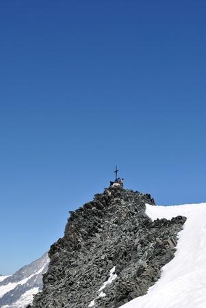 Saas Fee: the cross on the summit of allalinhorn Stock Photo