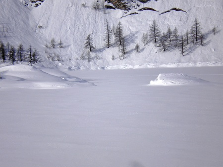 frozen lake in alpe devero photo