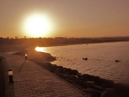 sunset on the coast of makadi, egypt photo