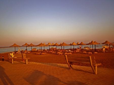 sunset on the beach of makadi, egypt photo