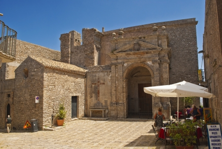 erice: small square in erice with an old church Stock Photo