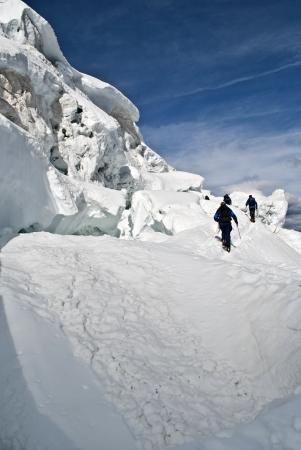 serac: alpinists on trift icefall climbing weissmies