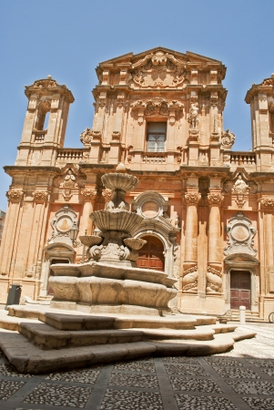 baroque church and fountain in marsala photo