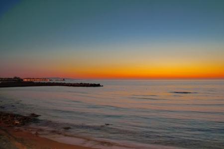 trapani: sunset on the beach of trapani