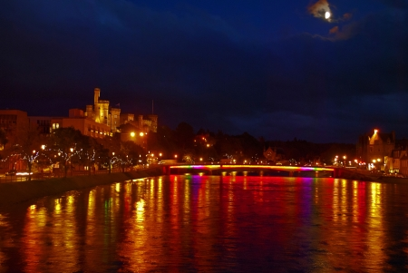 ness river: inverness by night from a bridge on river ness