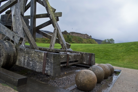 ancient catapult in front of urquhart castle photo