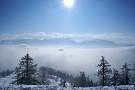 swiss alps: winter day in ovronnaz in swiss alps