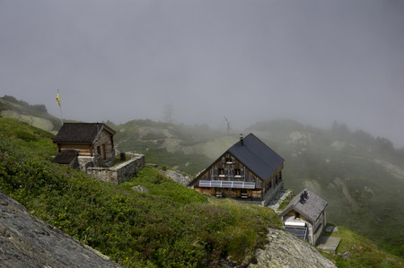 swiss alps: hut in swiss alps during summer