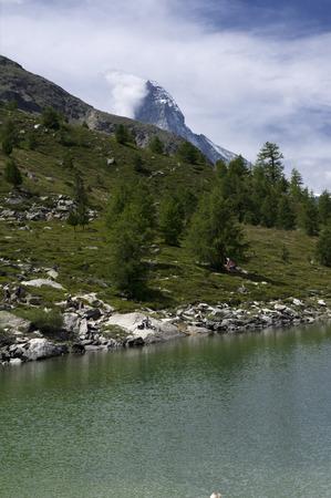 swiss alps: alpine lake in swiss alps